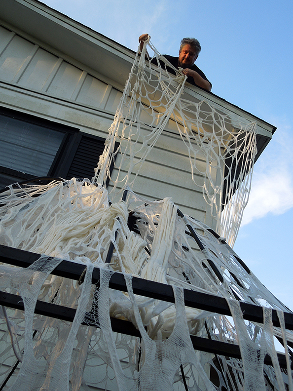 HowToHauntYourHouse_shawn_roof_webs.jpg